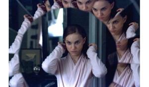 Nina --Natalie Portman-- looks into the mirror