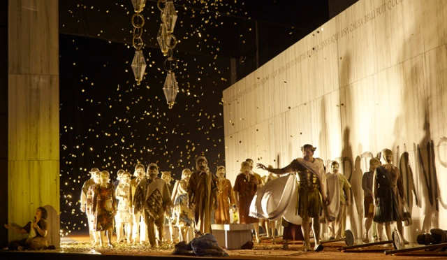 Michael Schade as Tito (standing), and the chorus in the Canadian Opera Company's production of La clemenza di Tito, 2013. director Christopher Alden (Photo: Michael Cooper)