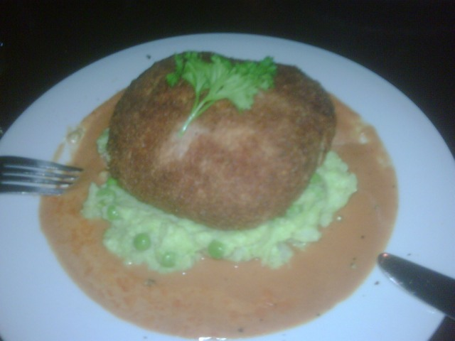 My salmon and leek cake sitting on green pea mash, surrounded by an impassable moat of whisky sauce