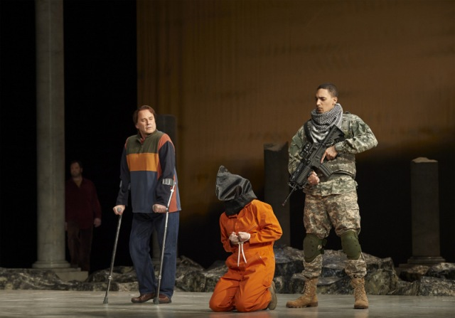 (l-r) David Daniels as Lichas (in background), Richard Croft as Hyllus, Lucy Crowe as Iole and Kaleb Alexander as Soldier in the Canadian Opera Company production of Hercules, 2014. Conductor Harry Bicket, director Peter Sellars, set designer George Tsypin, costume designer Dunya Ramicova and lighting designer James F. Ingalls. Photo: Michael Cooper