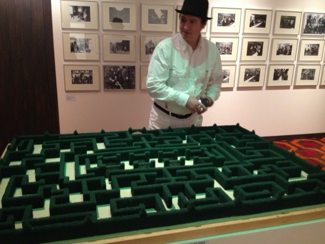 A droog and I contemplate a model of the maze from The Shining