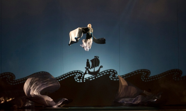 (left to right) Acrobats Antoine Marc, Sandrine Mérette and Ted Sikström in a scene from the Canadian Opera Company production of Love from Afar, 2012. Conductor Johannes Debus, original production by Daniele Finzi Pasca, set designer Jean Rabasse, costume designer Kevin Pollard, and lighting designers Daniele Finzi Pasca and Alexis Bowles. Photo: Chris Hutcheson