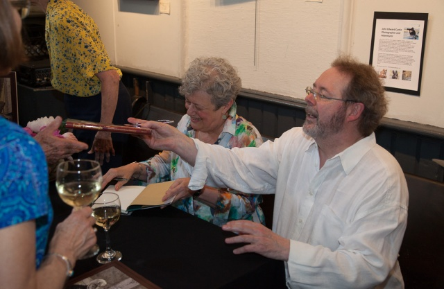 Linda (left) and Michael Hutcheon signing their book for an eager audience.
