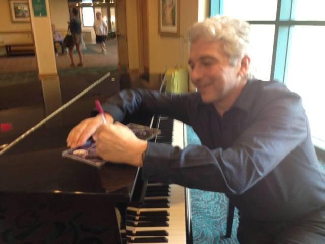 Peter Oundjian, autographing the Scheherazade CD for (lucky) me